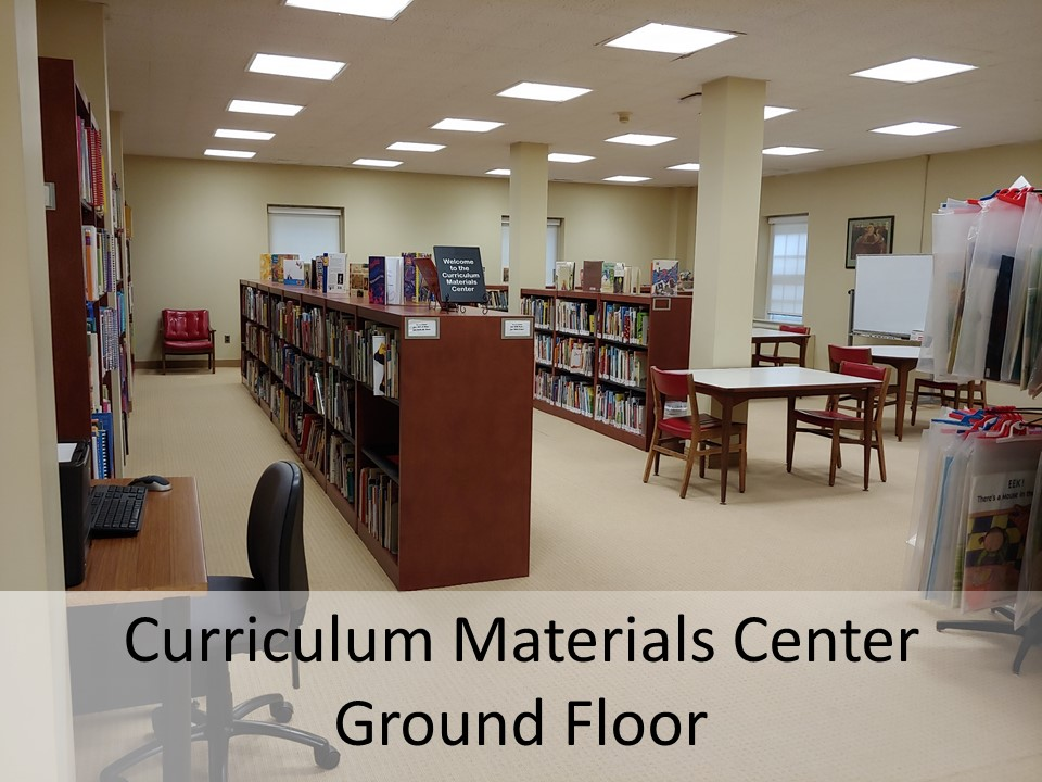 photo of curriculum materials center bookcases and tables with chairs