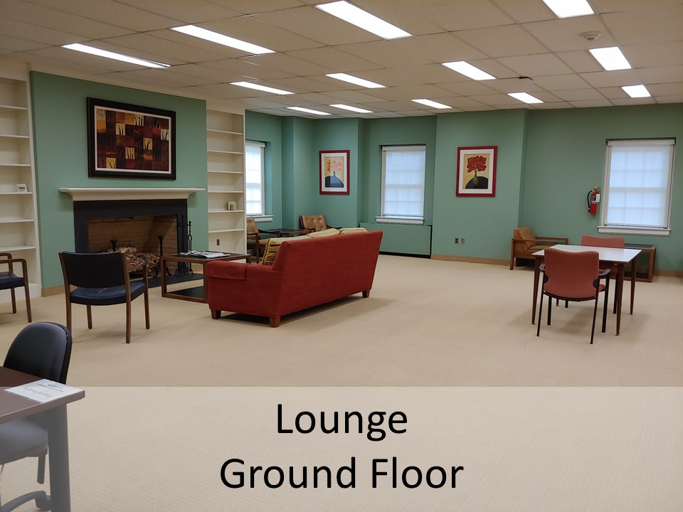photo of lounge area in front of fireplace